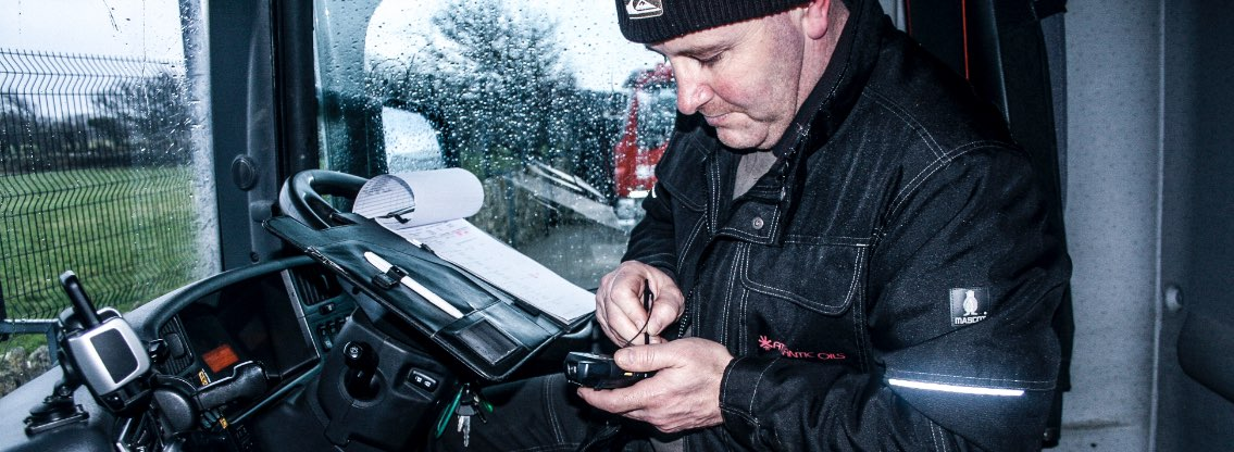 truck driver with hand held device